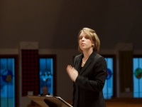 Holly conducting a concert