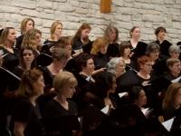 Chorus listens during a pre-concert sound check