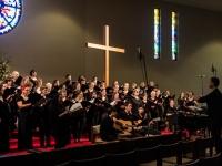 Choir rehearsing with musicians