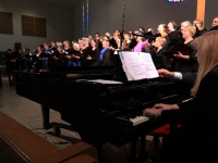 Andrea accompanying choir