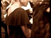 A chorus member laughs during a pre-concert sound check