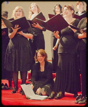 Tapestry Singers laughing during rehearsal